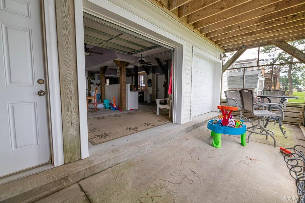 PARTY PATIO LEADS TO INDOOR KITCHEN AND PARTY AREA